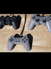 black Sony PS3 slim console with two controllers