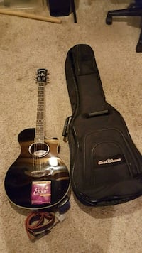 NEW acoustic guitar with accessories Pinckney, 48169