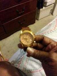 round gold analog watch with brown leather strap Washington, 20011