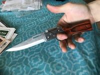 Brown and black handled switchblade with light (new) American Fork, 84003