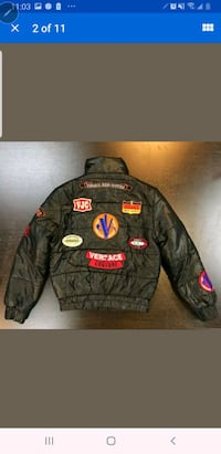 Womens xs to small vintage Versace jacket. $1000 r