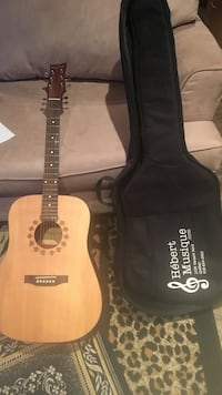 Brown acoustic guitar with gig bag Montréal, H4J 1Z4