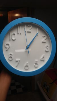 Blue And White Battery Operated Clock Bettendorf