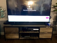 Tv stand .. big enough for 70 inches tv ...has a small damage on the side but you reverse it to the back... Surrey, V3S 7B1