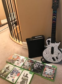 Black xbox 360 with games  Surrey, V4P 1G4