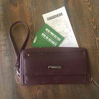 Burgundy Roots Zipup Wallet - new/ never used Vancouver, V5R 4X4