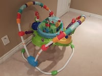 baby's multicolored jumperoo Milton