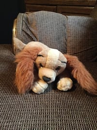 brown and white dog plush toy 26 mi