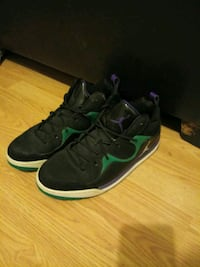 pair of black-and-green Nike basketball shoes 2300 mi
