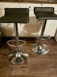 two stainless steel base black leather padded bar stools Barrie, L4M