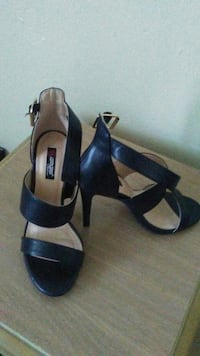 pair of black leather open toe heels
