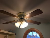 brown wooden 5-blade ceiling fan