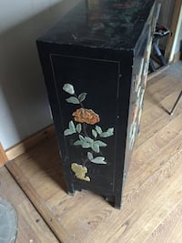 black and brown oriental wooden cabinet