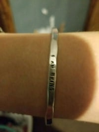I am being    Sterling silver open back bangle Waterloo, 50707
