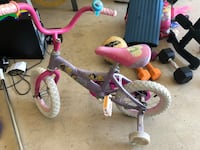 toddler's pink and white bicycle with training wheels Miramar, 33025