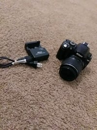 black Canon DSLR camera with lens