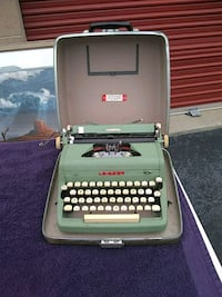 gray and black typewriter with case Herndon, 20171