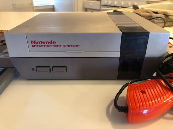Original Nintendo System with controllers, gun and games