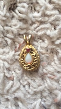 Gold and white opal center pendant
