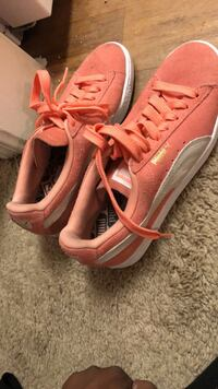 pair of pink-and-white Nike running shoes ATLANTA