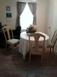 Table and chairs...Table has a leaf to make longer Wilmington, 28405