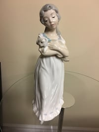 Tengra figurine girl carrying cat.  Mint condition