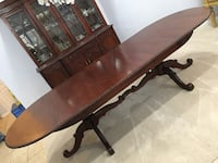 Mahogany Chippenale oval expandable antique dining table