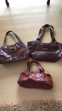Brown leather nine west purses. All our new or gently used. Seven dollars each.