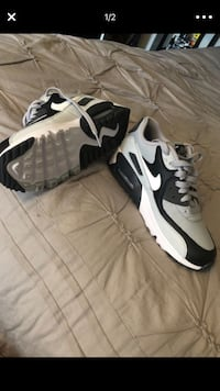 pair of white-and-black Nike Huarache Santa Ana, 92703