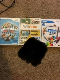 4 wii games and accessories 161 mi