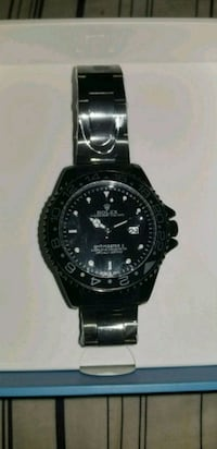 round black chronograph watch with silver link bracelet Toronto, M6K 1A6