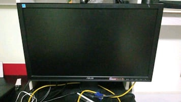 black HP flat screen LED monitor