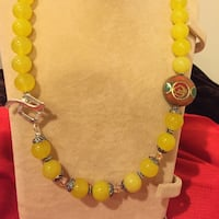 Brand new, habd made, steling silver and yellow Agate