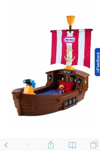 children's brown, red, and white Little Tikes pirate ship bed frame