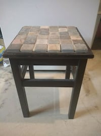 Artsy Stool with rock surface.