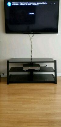 Black glass TV stand. Like new.  Los Angeles, 91605
