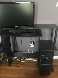 black flat screen TV with black wooden TV stand 47 km