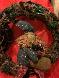 two green wreaths with hooks