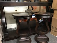 two black leather padded bar stools null