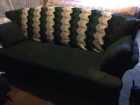 Dark green couch and love seat