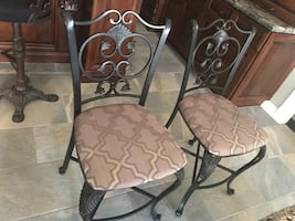 Two barstools tall counter chairs
