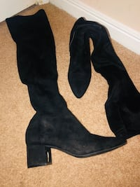 Knee high boots size 9 1/2 but can fit a 9