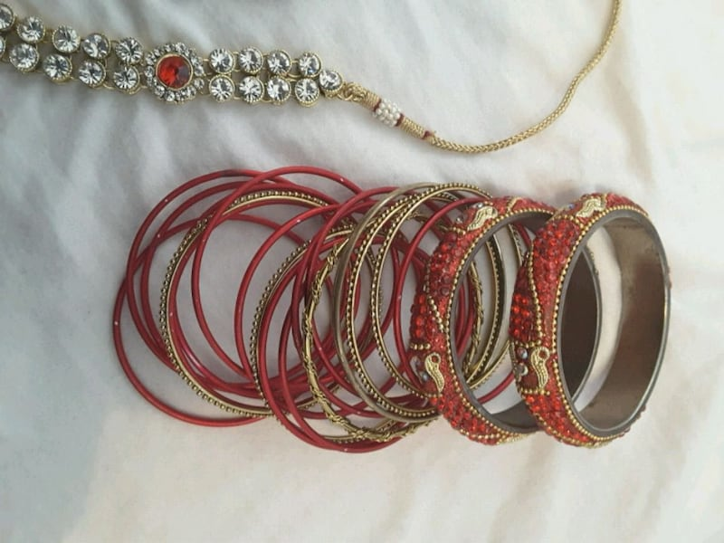 red and gold Indian  jewelry set a50dc73d-f5ab-4f0a-aadd-5b9f9b31afc1