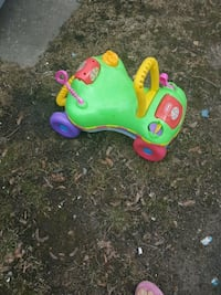 toddler's green, yellow, and red ride-on toy