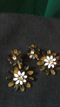 Four brown-and-white flower jewelries j crew New York, 11385