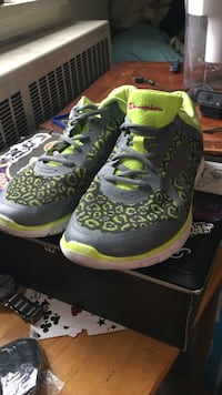 pair of grey-and-green Champion athletic shoes Winnipeg, R3C