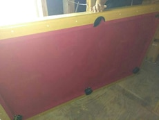 Foldable red and brown pool table