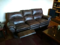 Leather couch with recliners on both sides