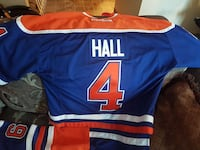 blue and orange Reebok Hall 4 jersey shirt