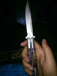 white and blue handled butterfly knife Toronto, M4X 1G4